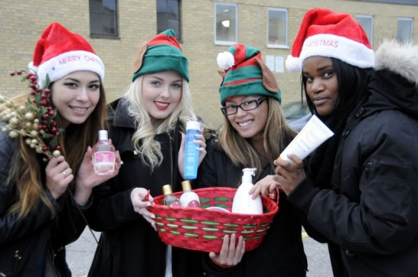 Left to right: Elena Wallace, 20, Megan Traversy, 19, Rillie Javellana, 25, Danielle Francis, 20 Products from Shoppers Drug Mart will be part of a gift basket, to be raffled off for the fundraiser. PHOTO: Hannah Hollingsworth