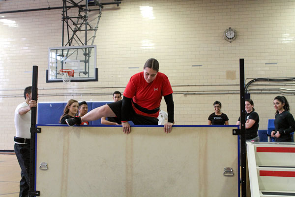 Photo by Travis Pereira A Lakeshore student tackles a hurdle during the OPP training session.
