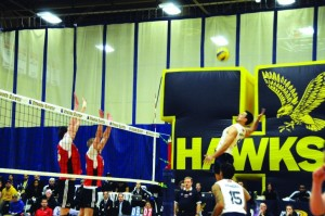 Photograph by Christina Succi Humber Hawks Trevor Wong attempts to put the team up three with a spike against the Fanshaw Falcons during the third set of their heartbreaking loss