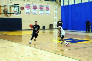 RJ Ramirez moves the ball up the court in practice. (Jeff Sehl)
