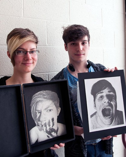 Brianne Whinfield, left, and Colin Frings, right, both first year Visual Arts and Design students, present their self-portraits (drawn with graphite pencil) which will be showcased in the upcoming exhibition at the University of Guelph-Humber Art Gallery, Embracing the Elite.
