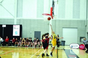 Humber's Natalie Hagopian drives to the basket for a lay-in during OCAA tournament action.