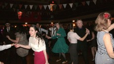 Photo by Shoynear Morrison.  Chelsea Futers (center in green) takes the floor with fellow swing dancers.