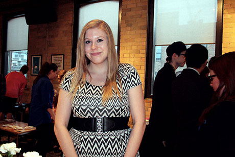 Third-year Graphic Design student Olivia Sanders at this year's Graphic Design Portfolio Show.