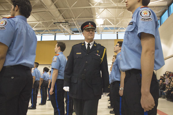 Toronto Police Chief Bill Blair greeting the members about to be officially invested into the 22 Division Toronto Police Service (Humber) Rover Crew at the annual Investitures ceremony on April 7, at the Toronto Police College. | Travis Pereira