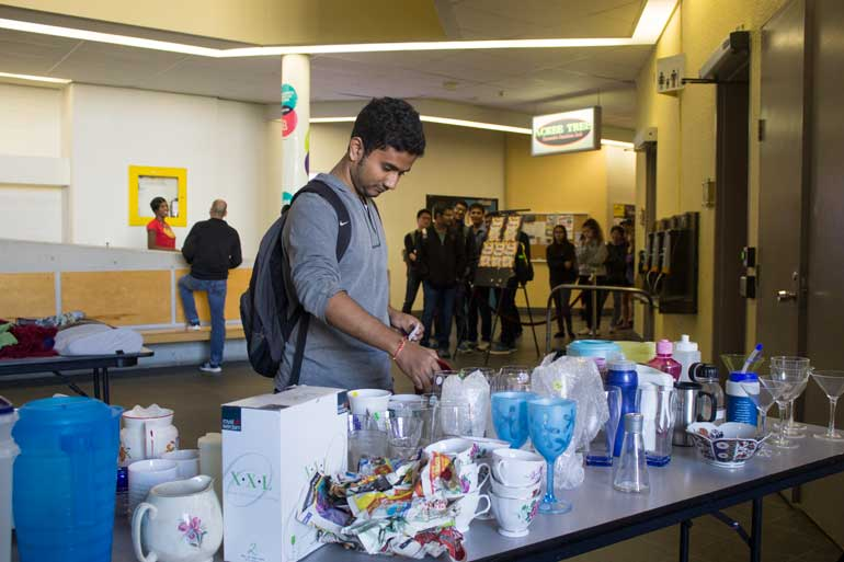 Students were encouraged to move quickly at Sept. 24 swap, though choosing was tricky for many. Items donated by faculty included dishes, clothing.