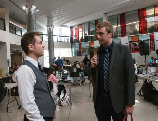 Former HSF president Tim Brilhante talks with Shawn Manhan at election forum on Sept. 23.