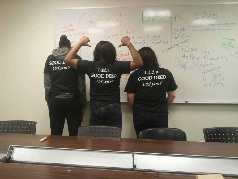 New recruits to the Good Deeds Club show off their new shirts at a club meeting during exam week in April 2014. Photo Courtesy of Mobeen Sheikh.
