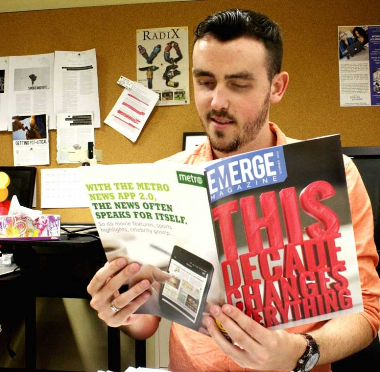 Michael Brown reading the 2014 Emerge Issue. Photo by Ashley Jagpal