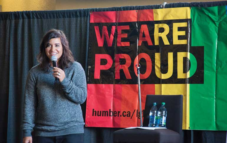 Comedian Sabrina Jalees promotes honest disclosure of sexual orientation and gender identity in Humber's North campus concourse on Oct. 9. Photo by: Evan Millar
