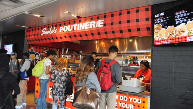 Students line up for Smoke's Poutinerie.  Photo by: Murissa Barrington