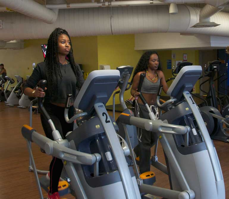 Lakeya Dunkly and Mariah Jeffers-Khan do a quick workout in the Humber athletics center.  Photo by: Chelsea Alphonso