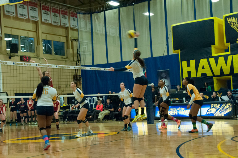 Humber's Thalia Hanniman hits the ball into Conestoga's end during the teams last home match of the semester. Humber will face Niagara this Sunday before taking mid-season break.  Photo by Aaron D'Andrea