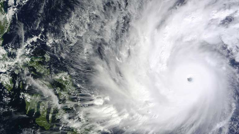On Dec. 4, the MODIS instrument aboard NASA's Terra satellite took this visible image of Super Typhoon Hagupit approaching the Philippines.  (NASA Goddard's MODIS Rapid Response Team)
