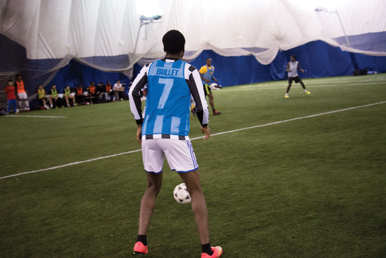 Kingsley Boasiako ready to receive the ball during tryouts for the men's indoor tea, but already calculating what he'll do. (Photo by Mathew Hartley)