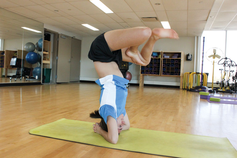 Ally Morin focuses on her inner balance and strength with yoga, a practice  some athletes say is great supplemental training. (Photo by Jessica Reyes)