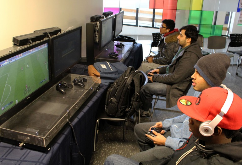 Humber students take a break from school to play some games with friends on the Xbox One in HSF's video game room. (Photo by Ryan Durgy)