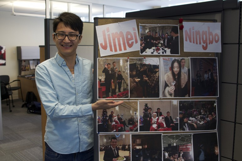 Chinese student Shupeng William Wang shows off pictures from the Humber-China partnership program