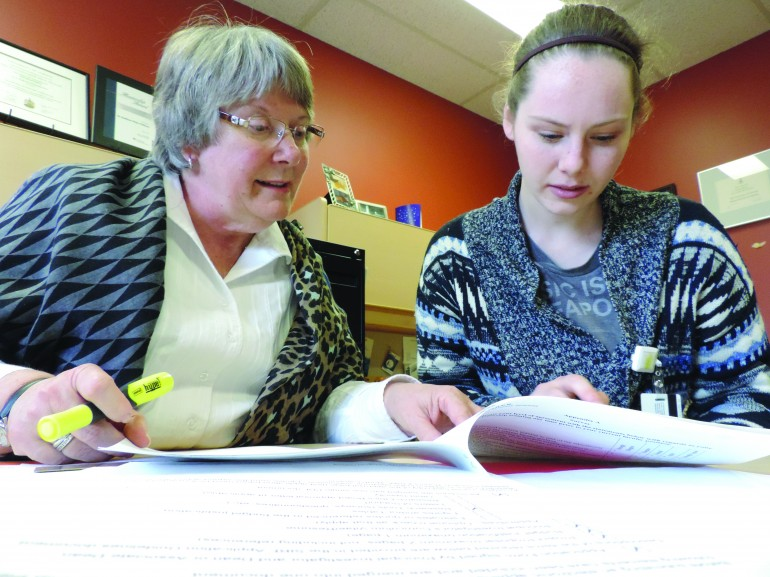 Kathleen White-Williams (left), a professor of the Bachelor of Nursing program, and Kaylee Fraser a third-year nursing student working on a research survey. (Photo by Nicole Williams)