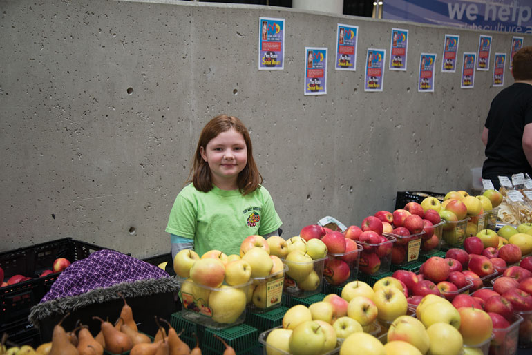 Shannen, daughter of Sun-Ray Orchards owner, Larry Short, sells apples and pears at the Humber College marketplace.