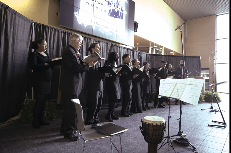 Photo by Aresell Joseph Aresell Joseph As more students and staff gather, The Nathaniel Dett Chorale perform their second song 'Drinking in the Wine,' which describes resilience, slavery and maintaining one's spirituality in the African Diaspora.