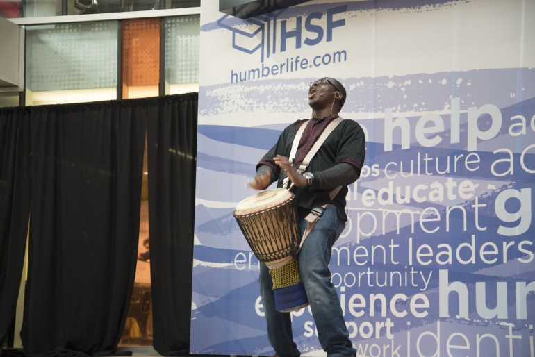 Babarinde Williams starts his presentation with a drum solo.