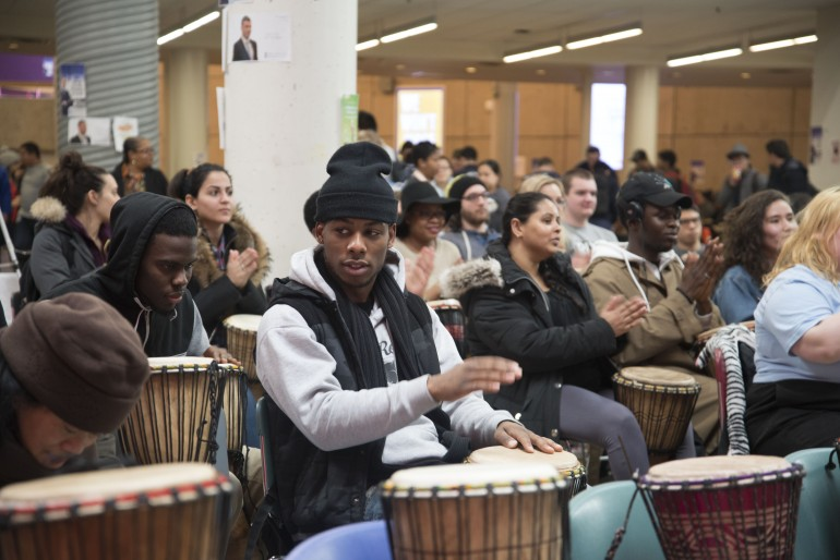 Humber College's students and faculty members participates in drumming workshop.