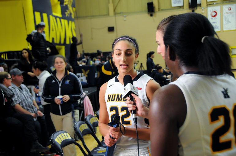 Saturdays player of the game, Natalie Hagopian is immediately surrounded by Humber media after shooting the game winner at the buzzer on Saturday Jan.31. (Mathew Hartley)