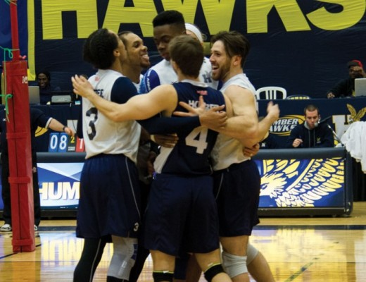 The Hawks celebrate a huge point during the second set of its 3-0 win over the Algonquin Thunder Sunday. (Ali Amad)