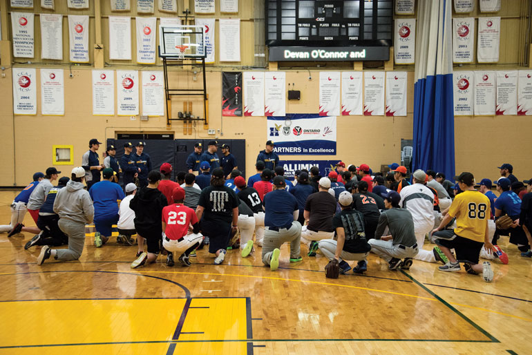 Men's Baseball head coach Denny Berni addresses a crowd of eager young prospects pooled from all over Southern Ontario. (Katherine Green)