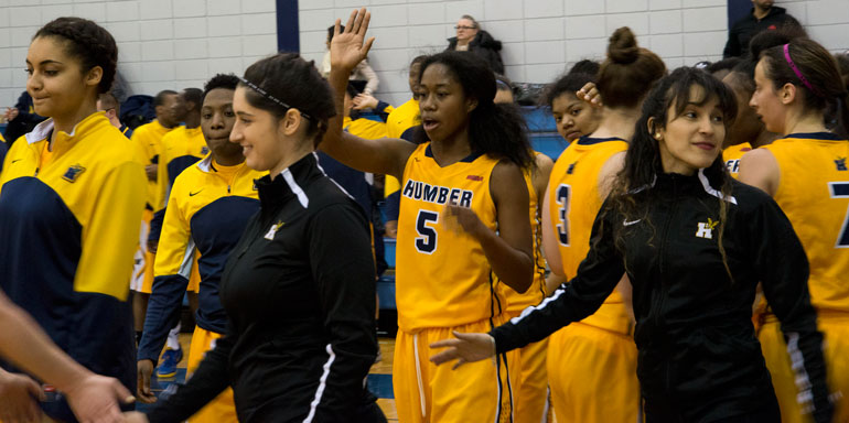 The Humber Hawks celebrate a big victory against the Sheridan Bruins where they nearly double their score. (Andy Redding)
