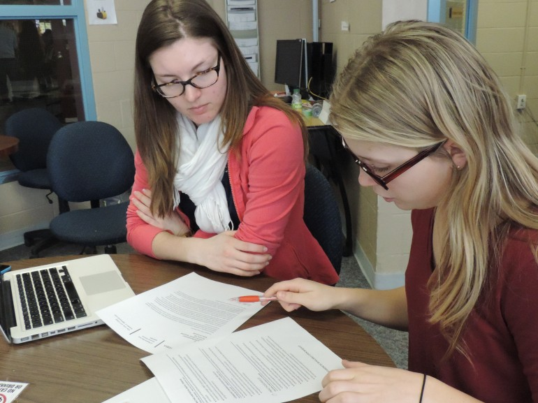 Heather Foell (left), 22, a Kinesiology student, gets help improving her resume for job applications from work-study student Allison Baker, 20. Allison is also a Kinesiology student who works at Humber's Career Centre as a part-time assistant advisor. (Nicole Williams)