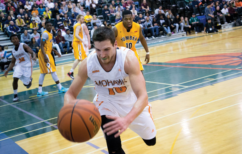 Mohawk's Andrew Cicuttini maintains possession during the Mountaineers 84-74 win over Humber in the OCAA Gold medal game. March 08. Durham College. (Mathew Hartley)