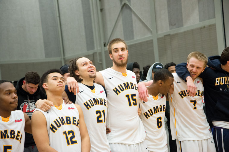 Humber Vule Grujic stands in the middle of his teammates as his play in the final minutes sealed Humber's 68-62 victory over VIU on Saturday. Hamilton. Ont. (Mathew Hartley)