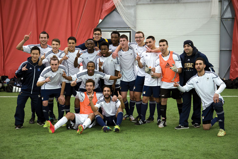 The Humber men's indoor soccer team celebrates winning the OCAA Championship at Redeemer on Saturday. (Andy Redding)