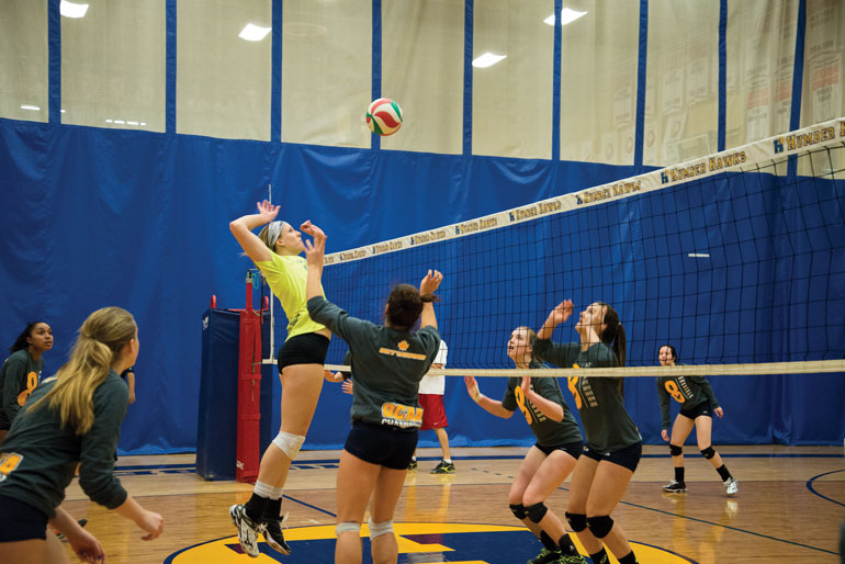 Humber's varsity volleyball team practices for nationals after winning the OCAA championships. (Jessica Reyes)