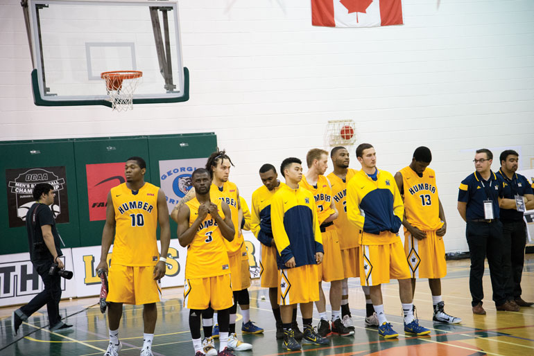 Dejected Humber Hawks stand together to receive silver medals at OCAA championships at Durham College on March 8. (Mathew Hartley)