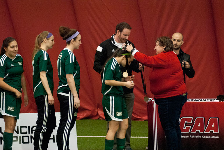 Members of St. Clair College's women's indoor soccer team being awarded their gold medals at the OCAA provincial championship. (Alexandra Martino)