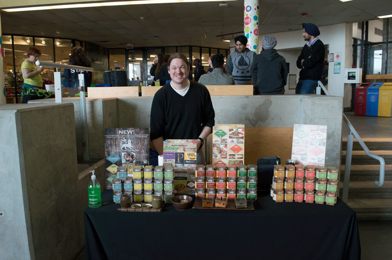 Rob Heidenreich, co-founder of Saha International Cuisine with his supply of international sauces and marinades, was a vendor at HSF farmers' market. (Sarah Trumbley).