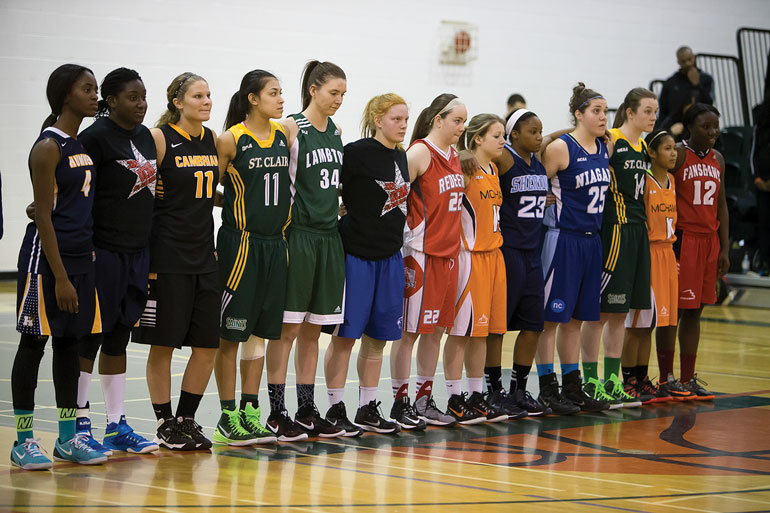 Hawks Mary Asare (far left) and Llyandra Kerr (second left) line up with the rest of the West Region all-star team prior to the OCAA all-star game on March 28. (Courtesy of Scott Dennis)