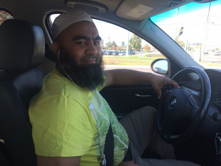 Uber driver Shah Alakoozi of Cornwall, Ont., says he loves the flexibility the ridesharing company offers its drivers.  (Photo: Clare Jenkins)