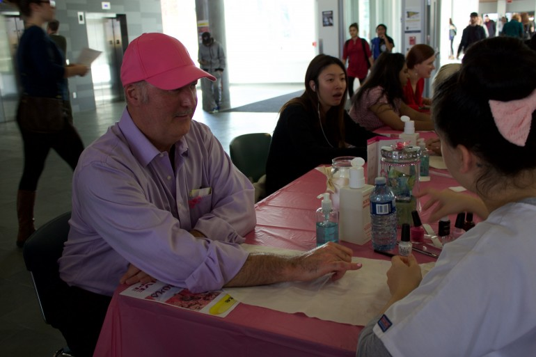 Richard Mitchell, We Are Hope event organizer, takes his turn at the Spa Management table. He organized the event after determining that  Humber as a community could do more to help fight breast cancer. (Photo: Ken Kellar)