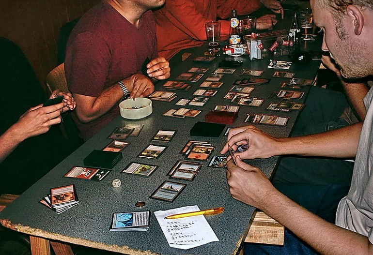 A group plays a game of magic. Photo credit: Andre Engels