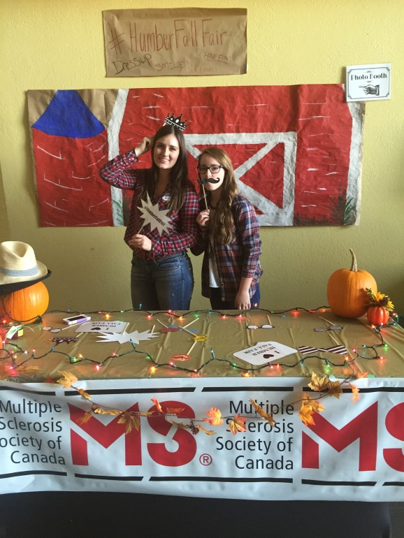 Brett Doane (left) and Victoria Bernard pose at photo booth at Humber's Fall Fair, held at North campus Tuesday. (Photo: Adriana DiSanto)
