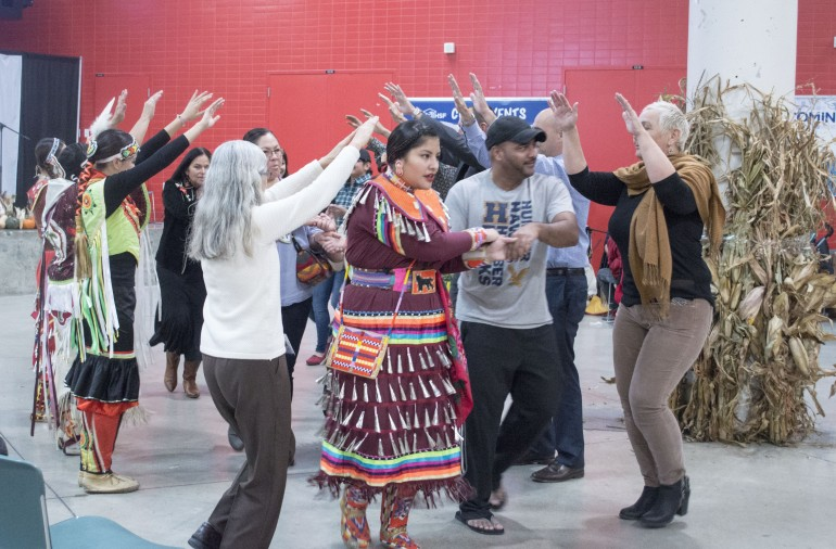 Dancers and guests at the Humber North Campus' 5th annual Powwow participate in the Partner's Dance. Nov. 10, 2015. (Photo: Delia MacTaggart)
