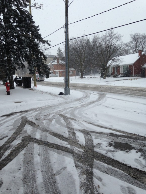 Tire tracks cover freshly fallen snow on Waterloo, ON. Streets in 2013. (Photo: Laura Dart)