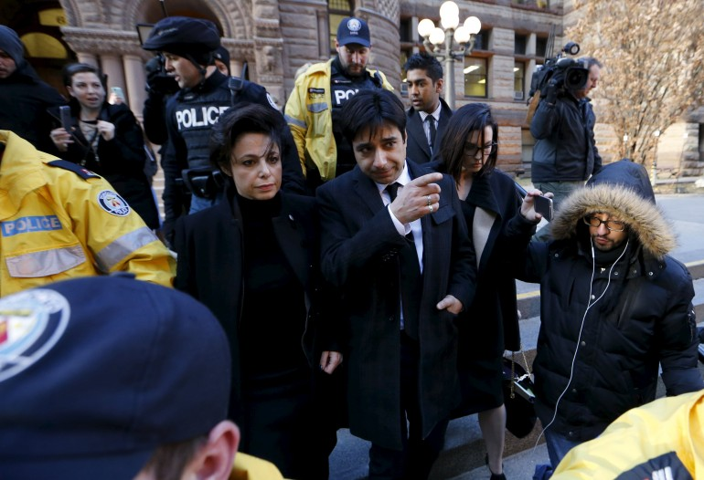 Jian Ghomeshi, former celebrity CBC-Radio host who has been charged with multiple counts of sexual assault, leaves the courthouse after first day of his trial alongside his lawyer Marie Henein (L), in Toronto, Feb. 1. (REUTERS/MARK BLINCH)