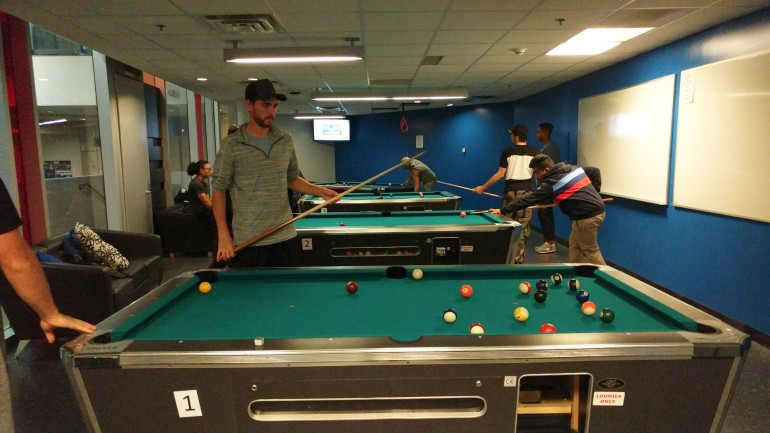 Students unwind with a game of pool in Ignite's game room