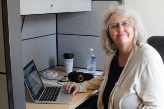 New media professor, Sherry Coman, pictured in her office at Lakeshore, created a panel called Higher Learning: Emerging Filmmakers Talk Spiritual and Cultural Identity.