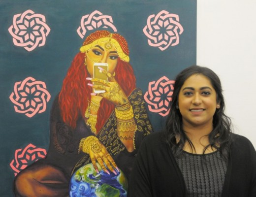 Toronto artist Nimisha Bhanot stands next to her piece Talking Back with the Selfie Gaze at the opening reception of the Returning the Gaze exhibit at Humber L Space Gallery, Lakeshore Campus. Photo taken by Brett McGarry on Oct 14, 2016.